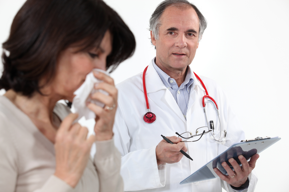 Sick patient with doctor
