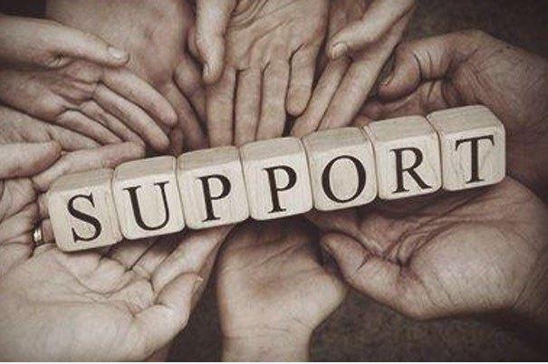 Support word surrounded by hands