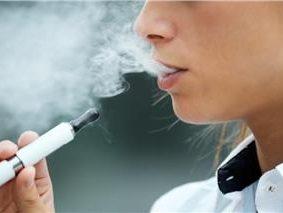 Teen using an e-cigarette vaping