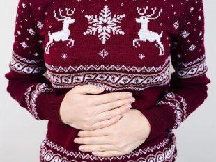 women holding stomach